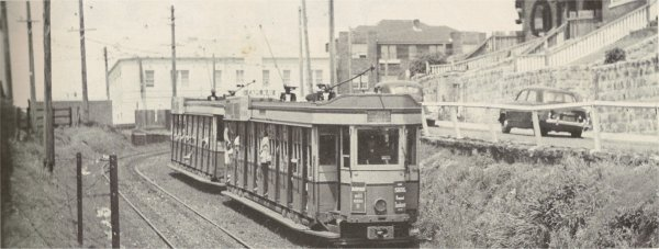 Tram coming down to Bondi Beach.  Bondi Beach YHA in the background